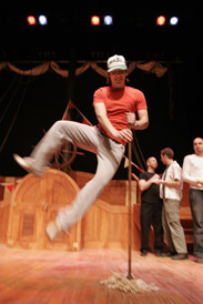 Music undergrad Jonathan Patterson kicks up his heels at a rehearsal for the McGill Savoy Society's 41st annual production - H.M.S. Pinafore (or, the Lass that Loved a Sailor).